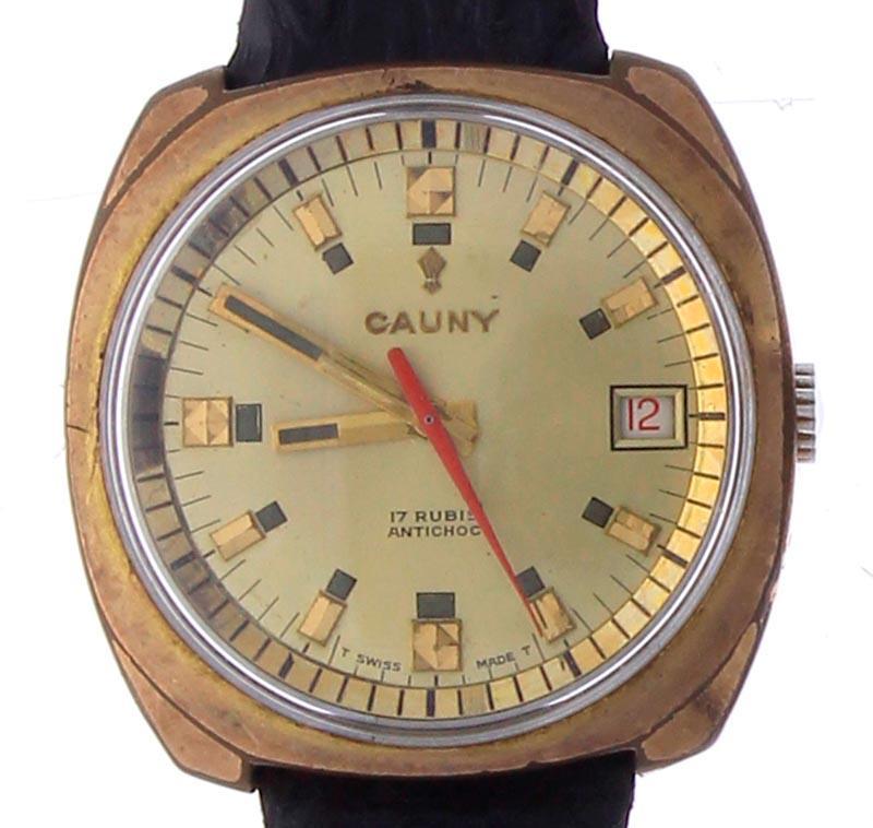 c0b21bf2b3f Lote 3332 - Relógio de pulso marca CAUNY PRIMA Swiss 17 rubis waterproof  antichoc 5 ATMOS com bracelete em pele de cobra e plaque em ouro movimento  a corda ...