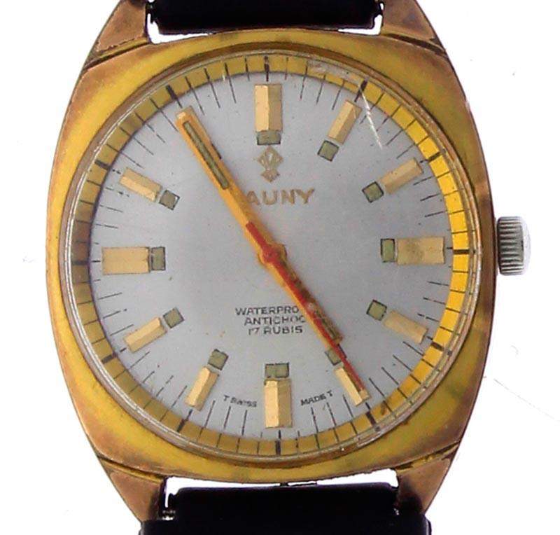 c691a03cc15 Lote 3460 - Relógio de pulso de marca CAUNY PRIMA Swiss 17 rubis waterproof  antichoc plaque a ouro e calendário a trabalhar movimento a corda com o  nº574743 ...