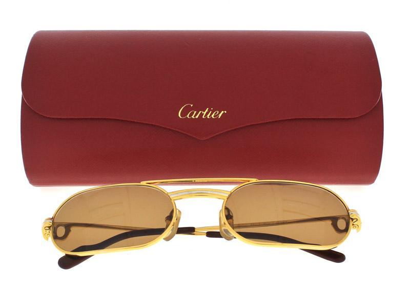 Lote 4017 - CARTIER - Óculos de Sol. Armação dourada. Com um pvp em novos  de € 495. Nota  com estojo. - Current price  €160 088de455a5