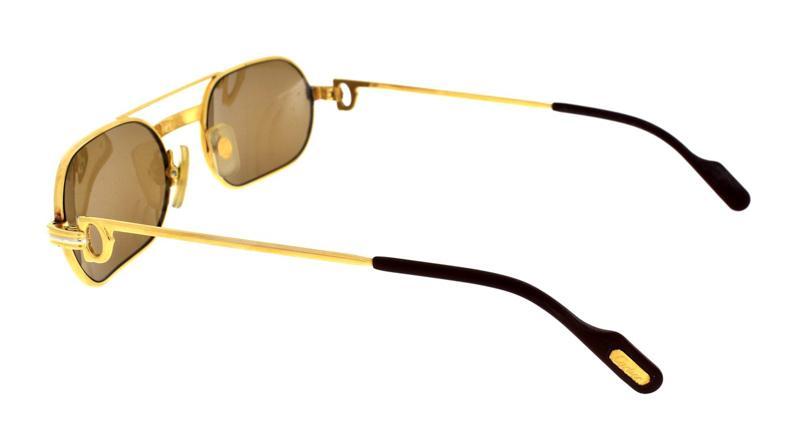 Lote 4017 - CARTIER - Óculos de Sol. Armação dourada. Com um pvp em ... 401fc7b9ab