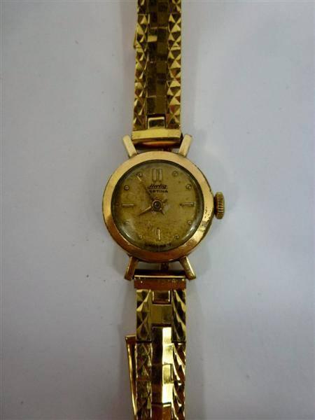 8650889025a Lote 198 - Relógio de senhora dourado usado antigo marca HERTIG certina