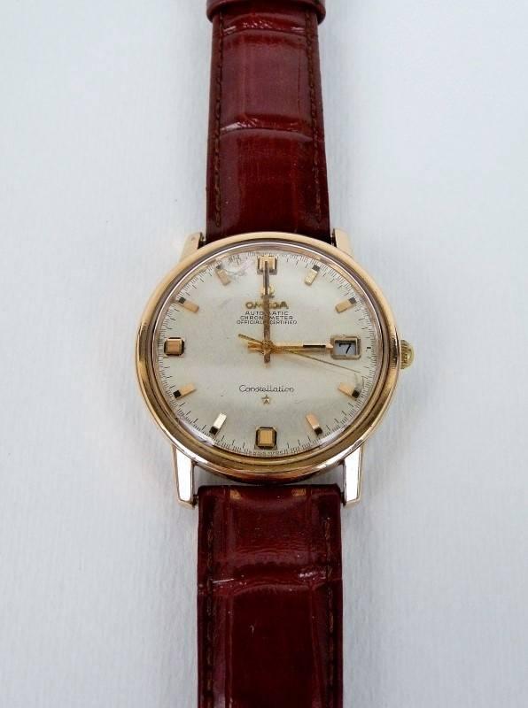 8e3611ec928 Lote 2826 - Relógio Omega vintage Constellation Automático Chronometer  Certified Date em aço e ouro 18k. Mostrador prateado com calendário